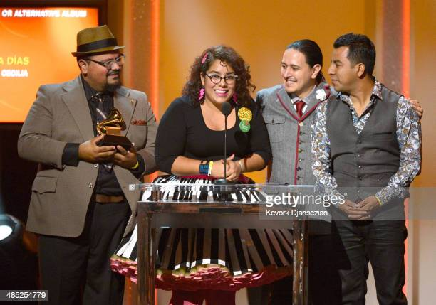 Musicians Miguel Ramirez La Marisoul Alex Bendana and Jose Carlos of La Santa Cecilia accept the Best Latin Rock Urban or Alternative Album award for...