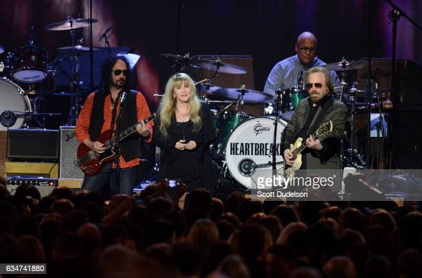 Musicians Mike Campbell Stevie Nicks Steve Ferrone and Tom Petty perform onstage during the MusiCares Person of the Year event on February 10 2017 in...