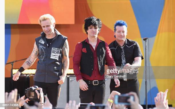 Musicians Mike Dint Billie Joe Armstrong and Tre Cool perform on ABC's 'Good Morning America' at Rumsey Field in Central Park on May 19 2017 in New...