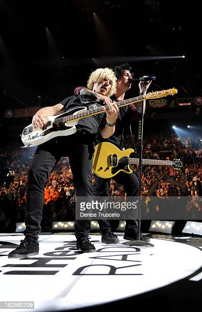 Musicians Mike Dirnt and Billie Joe Armstrong of Green Day perform onstage during the 2012 iHeartRadio Music Festival at the MGM Grand Garden Arena...