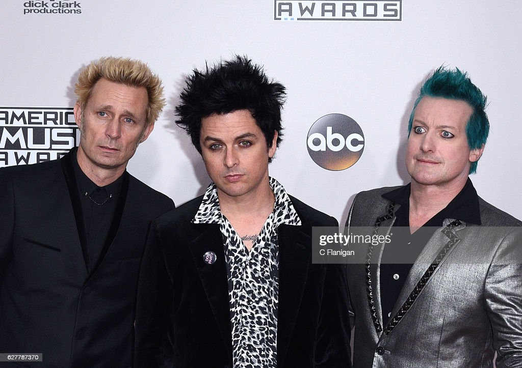 Musicians Mike Dirnt, Billie Joe Armstrong and Tré Cool of Green Day attends the 2016 American Music Awards at Microsoft Theater on November 20, 2016 in Los Angeles, California.