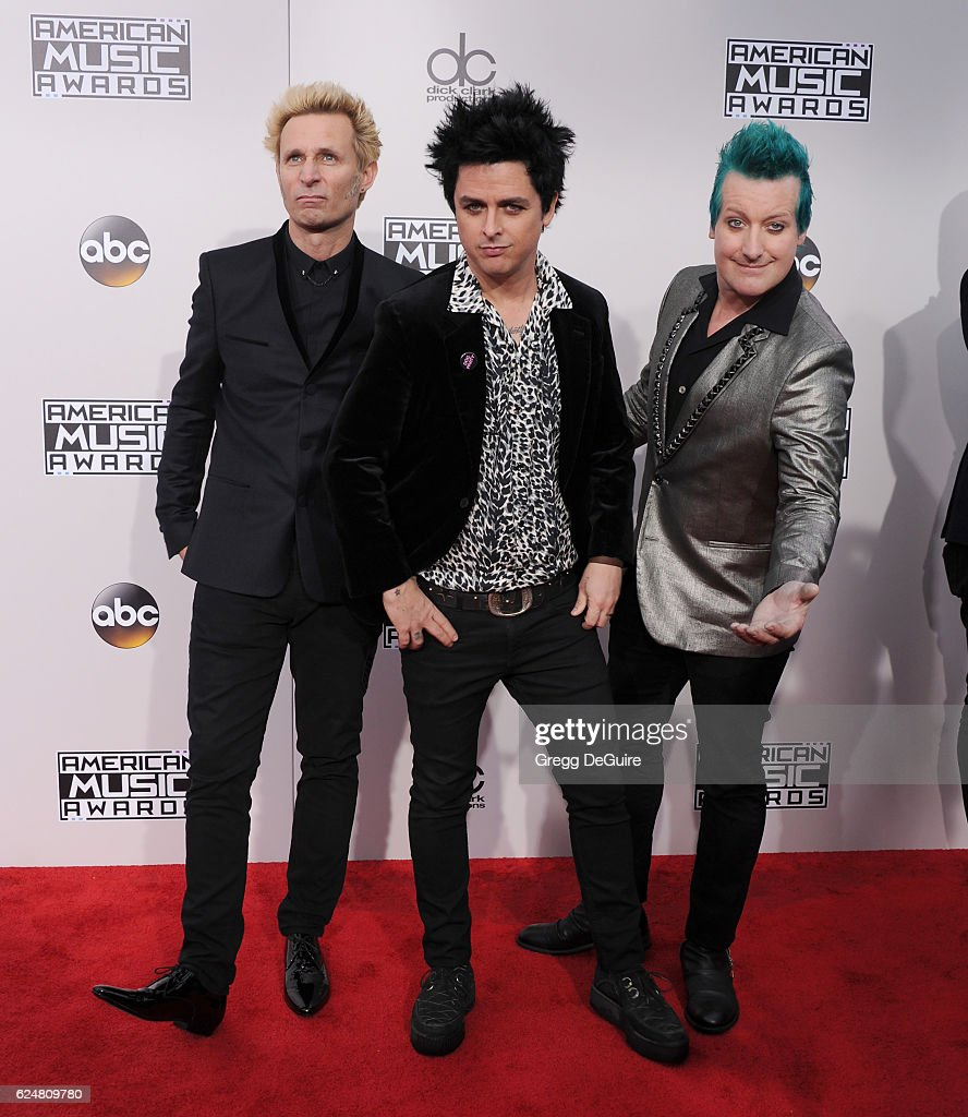 Musicians Mike Dirnt, Billie Joe Armstrong and Tre Cool of Green Day arrive at the 2016 American Music Awards at Microsoft Theater on November 20, 2016 in Los Angeles, California.