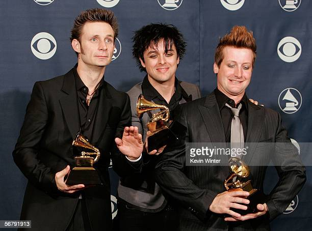 "Musicians Mike Dirnt, Billie Joe Armstrong and Tre Cool pose with their Record of the Year award for ""Boulevard of Brolen Dreams"" in the press room..."