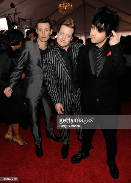 Musicians Mike Dirnt Tre Cool and Billie Joe Armstrong of the band Green Day arrive at the 52nd Annual GRAMMY Awards held at Staples Center on...