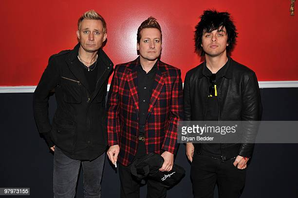 Musicians Mike Dirnt Tre Cool and Billie Joe Armstrong of the band Green Day attend the cast of Broadway's American Idiot final sound check at St...