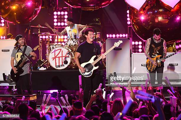 Musicians Mike Fuentes Vic Fuentes Jaime Preciado and Tony Perry of the band Pierce the Veil performs onstage at the MTV Fandom Awards San Diego at...