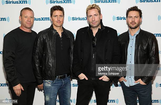 Musicians Mike Kroeger Daniel Adair Chad Kroeger and Ryan Peake of Nickelback visit SiriusXM Studios on November 20 2014 in New York City