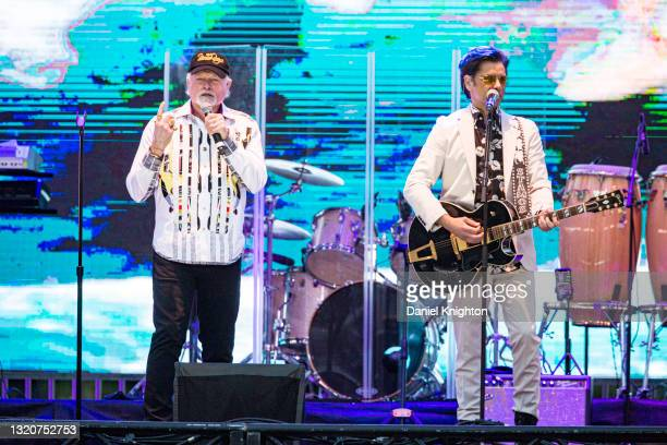 Musicians Mike Love and John Stamos of The Beach Boys perform on stage at PETCO Park on May 29, 2021 in San Diego, California.
