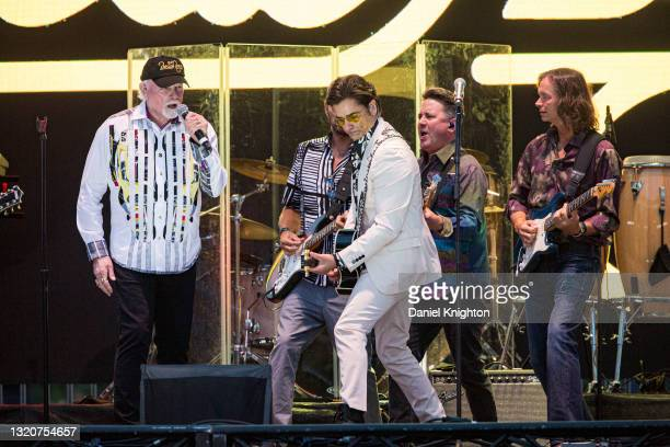 Musicians Mike Love, Christian Love, John Stamos, Keith Hubacher, and Scott Totten of The Beach Boys perform on stage at PETCO Park on May 29, 2021...