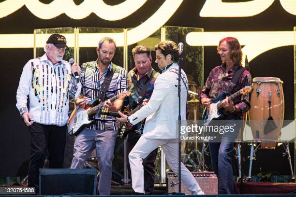 Musicians Mike Love, Christian Love, Keith Hubacher, John Stamos, and Scott Totten of The Beach Boys perform on stage at PETCO Park on May 29, 2021...