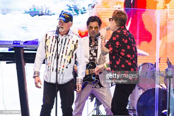 Musicians Mike Love, John Stamos, and Mark McGrath of The Beach Boys perform on stage at PETCO Park on May 29, 2021 in San Diego, California.