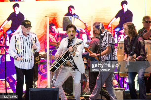 Musicians Mike Love, John Stamos, Christian Love, and Scott Totten of The Beach Boys perform on stage at PETCO Park on May 29, 2021 in San Diego,...