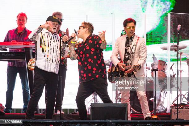Musicians Mike Love, Mark McGrath, and John Stamos of The Beach Boys perform on stage at PETCO Park on May 29, 2021 in San Diego, California.