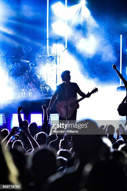 Musicians Mike Malinin and John Rzeznik of the Goo Goo Dolls perform at The Greek Theatre on September 13 2017 in Los Angeles California