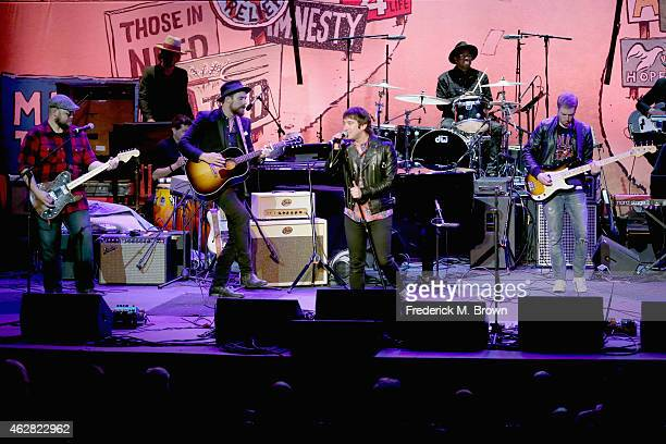 Musicians Mike Retondo, Tim Lopez, Tom Higgenson, De Mar Hamilton and Dave Tirio of musical group Plain White T's perform onstage during the GRAMMY...