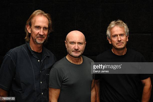 Musicians Mike Rutherford Phil Collins and Tony Banks pose before talking about their band Genesis during a press conference before the dress...