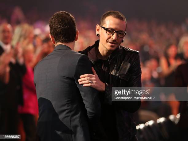 Musicians Mike Shinoda and Chester Bennington of Linkin Park in the audience at the 40th American Music Awards held at Nokia Theatre LA Live on...