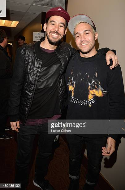 Musicians Mike Shinoda and Pete Wentz attend day one of the 25th annual KROQ Almost Acoustic Christmas at The Forum on December 13, 2014 in...