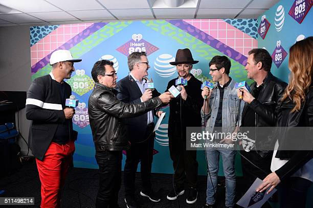 Musicians Mikey Craig and Jon Moss of Culture Club iHeartRadio personality Sean Valentine singer Boy George of Culture Club iHeartRadio personality...