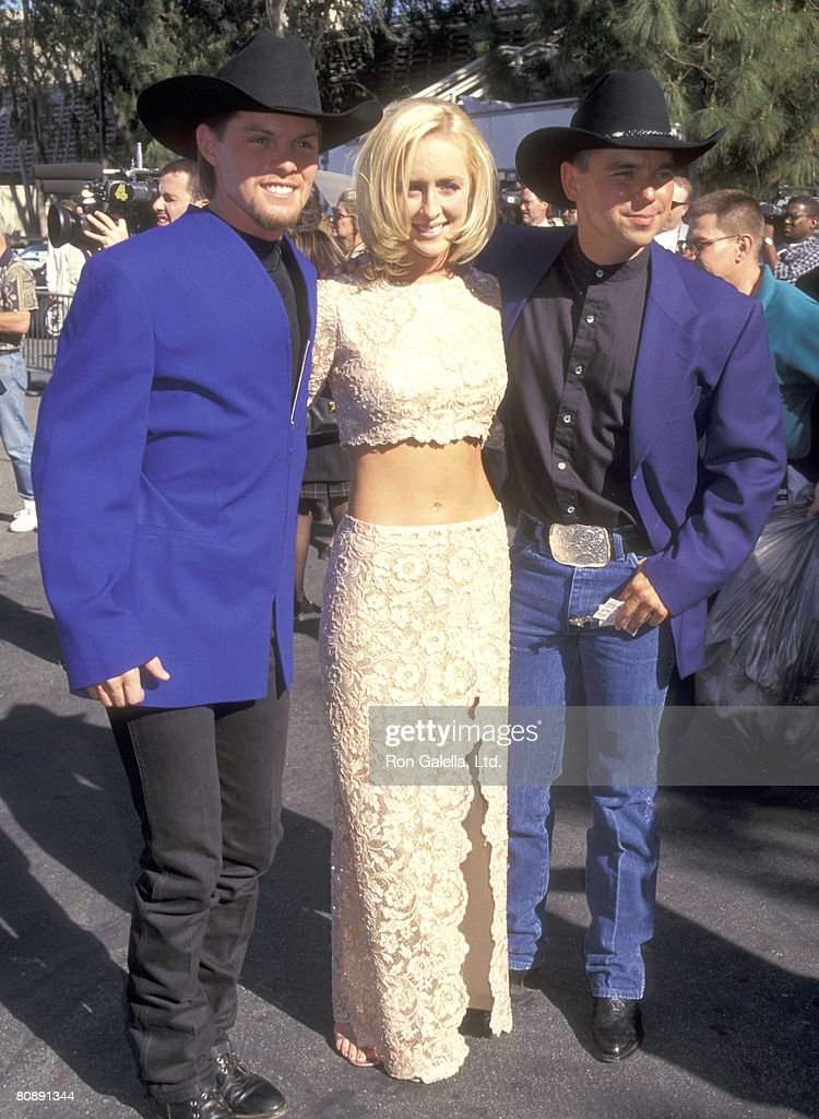 Musicians Mindy McCready, Kenny Chesney (right), and guest attend the 32nd Annual Academy of Country Music Awards on April 23, 1997 at Universal Amphitheatre in Universal City, California.