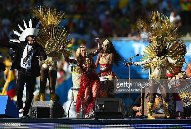 Musicians Musician Carlinhos Brown and Shakira perform during the closing ceremony prior to the 2014 FIFA World Cup Brazil Final match between...