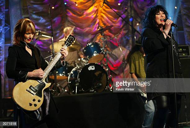 """Musicians Nancy and Ann Wilson of Heart perform on """"The Tonight Show with Jay Leno"""" at the NBC Studios June 10, 2003 in Burbank, California."""
