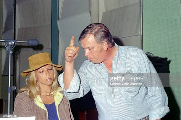 Musicians Nancy Sinatra and Billy Strange work in the studio on November 22 1969 in Los Angeles California
