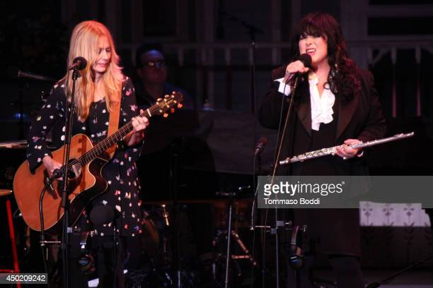 Musicians Nancy Wilson and Ann Wilson of Heart attend the a Prairie Home Companion helt at The Greek Theatre on June 6 2014 in Los Angeles California