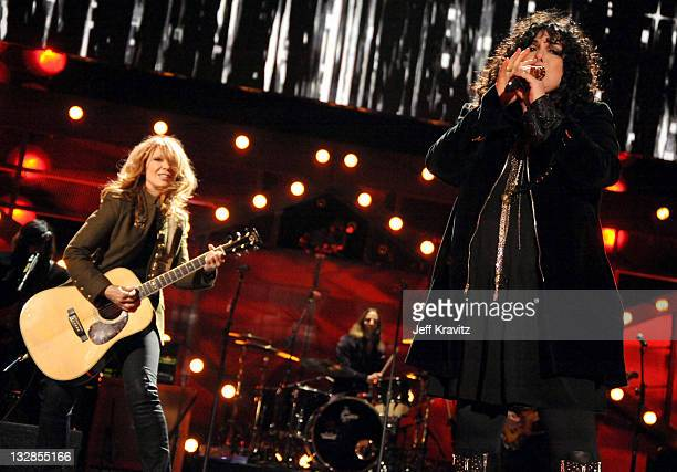 Musicians Nancy Wilson and Ann Wilson of Heart perform onstage during 'VH1 Divas Salute the Troops' presented by the USO at the MCAS Miramar on...