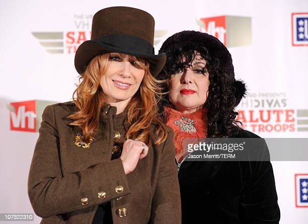 """Musicians Nancy Wilson and Ann Wilson of the band Heart pose in the press room during """"VH1 Divas Salute the Troops"""" presented by the USO at the MCAS..."""