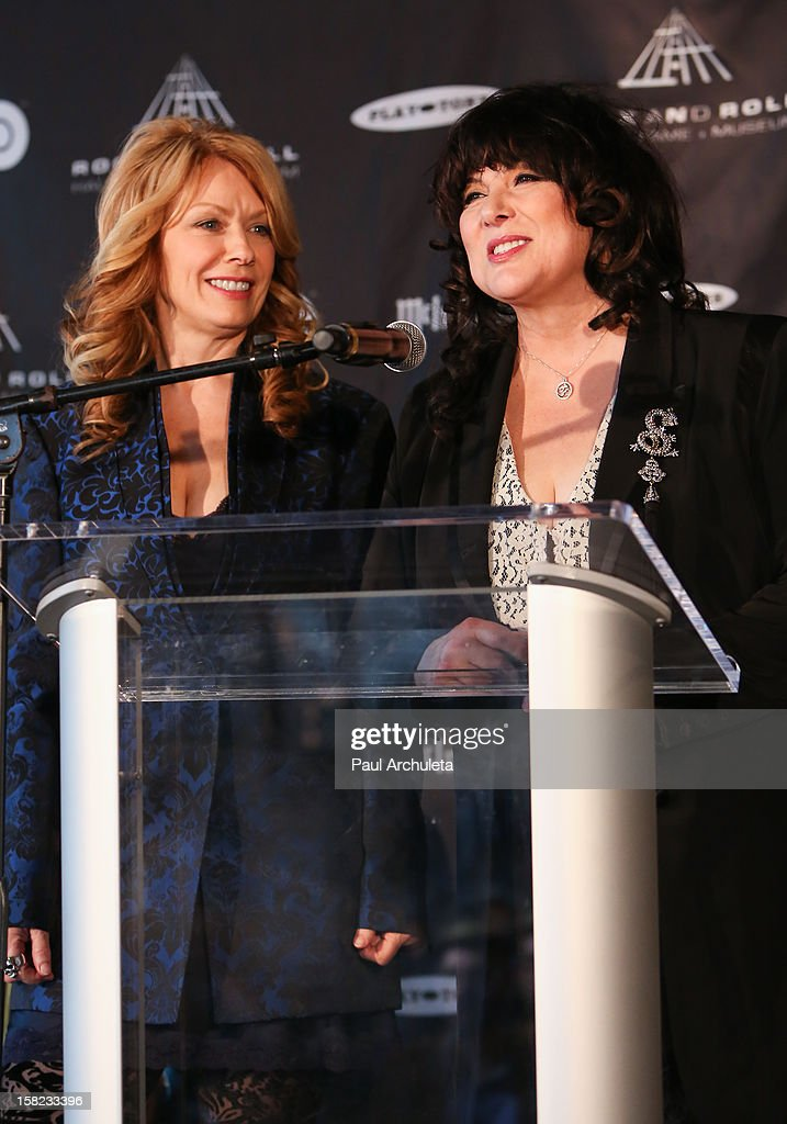 Musicians Nancy Wilson (L) and Ann Wilson (R) of the Rock Band Heart attend the announcements for the 2013 inductees to the 28th annual Rock And Roll Hall of Fame induction ceremony at Nokia Theatre LA Live on December 11, 2012 in Los Angeles, California.