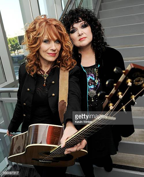 """Musicians Nancy Wilson and Ann Wilson of the rock band Heart pose at MusiCares' """"An Evening with Heart"""" at The Grammy Museum on May 24, 2010 in Los..."""