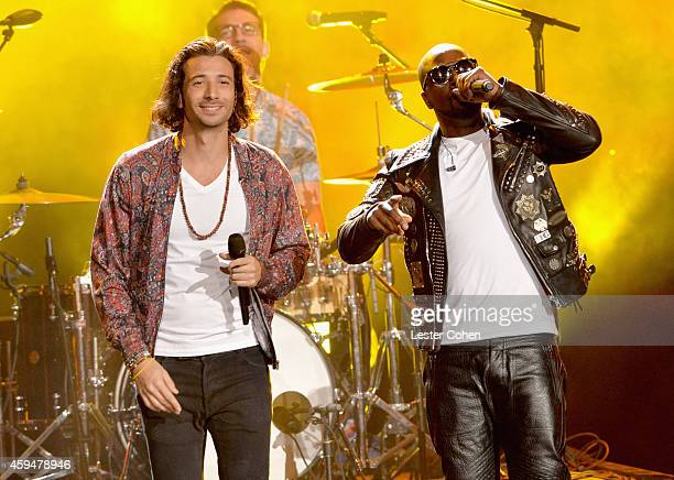 Musicians Nasri of Magic and Wyclef Jean perform onstage at the 2014 American Music Awards at Nokia Theatre LA Live on November 23 2014 in Los...