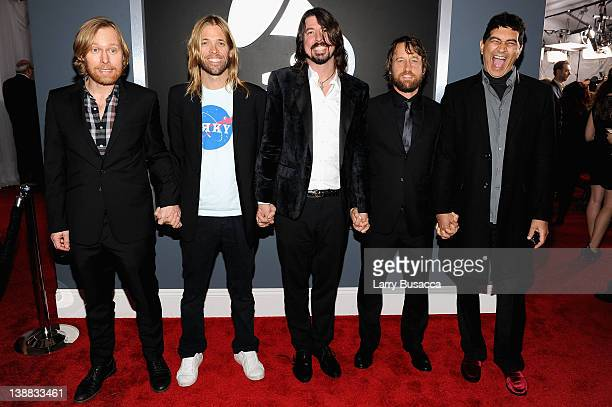 Musicians Nate Mendel Taylor Hawkins Dave Grohl Chris Shiflett and Pat Smear of Foo Fighters attend at the 54th Annual GRAMMY Awards held at Staples...