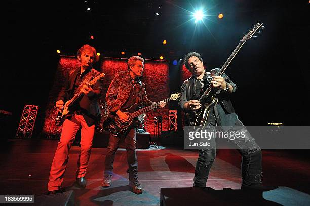 Musicians Neal Schon Ross Valory and Jonathan Cain of Journey perform onstage at the International Convention Center on March 12 2013 in Osaka Japan