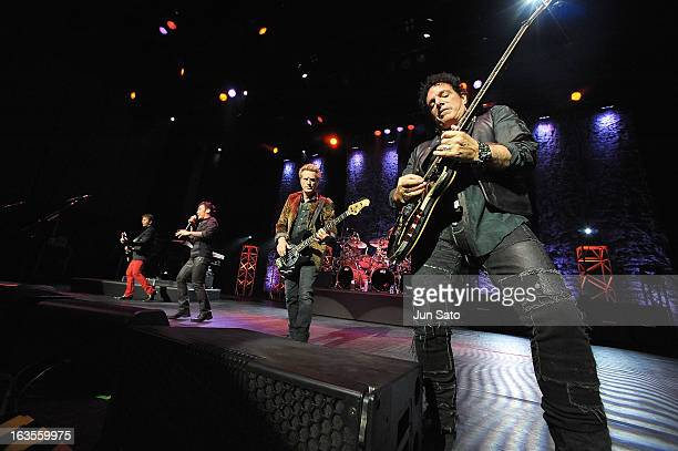 Musicians Neal Schon Ross Valory Arnel Pineda and Jonathan Cain of Journey perform onstage at the International Convention Center on March 12 2013 in...