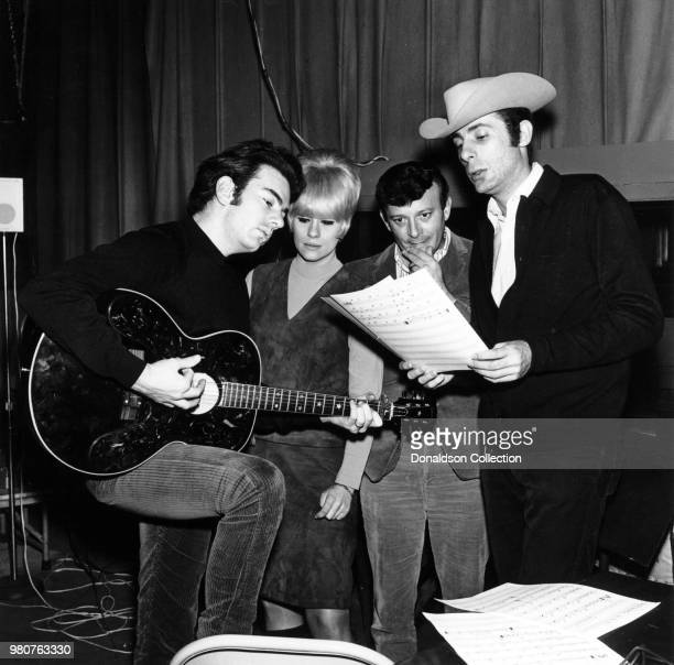 Musicians Neil Diamond Ellie Greenwich Bert Burns and Jeff Barry work up a song in the studio in 1966 in New York New York