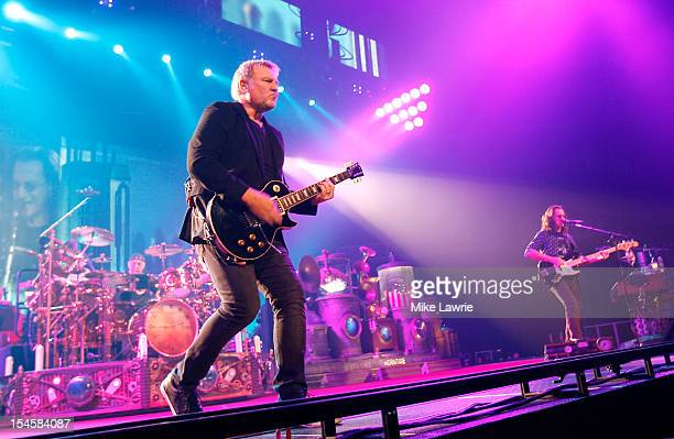 Musicians Neil Peart Alex Lifeson and Geddy Lee of Rush performs at the Barclays Center on October 22 2012 in the Brooklyn borough of New York New...
