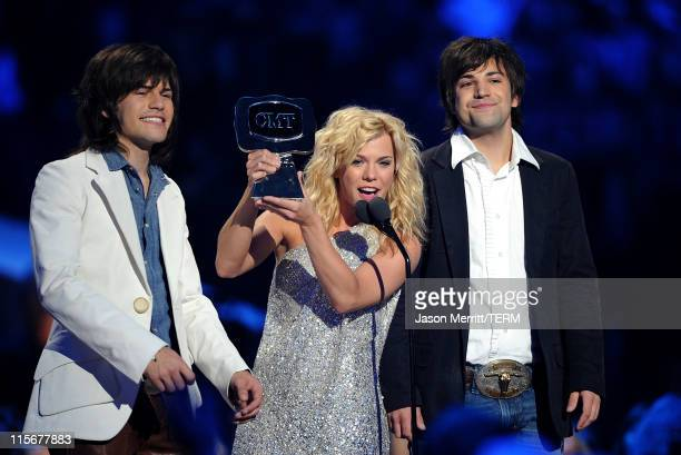 Musicians Neil Perry Kimberly Perry and Reid Perry of The Band Perry accept USA Weekend Breakthrough Video of the Year award on stage at the 2011 CMT...