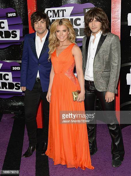 Musicians Neil Perry Kimberly Perry and Reid Perry of The Band Perry attend the 2013 CMT Music awards at the Bridgestone Arena on June 5 2013 in...