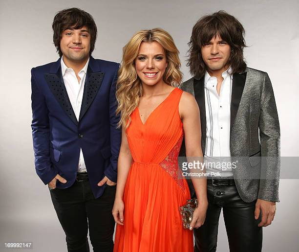 Musicians Neil Perry Kimberly Perry and Reid Perry of The Band Perry pose at the Wonderwall portrait studio during the 2013 CMT Music Awards at...