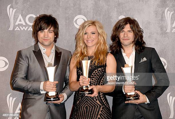 Musicians Neil Perry Kimberly Perry and Reid Perry pose in the press room with the Best Vocal Group award during the 49th Annual Academy of Country...