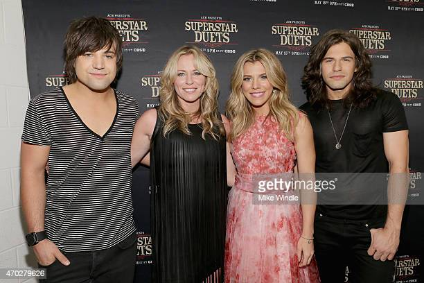 Musicians Neil Perry of The Band Perry Deana Carter Kimberly Perry and Reid Perry of The Band Perry pose in the press room during ACM Presents...