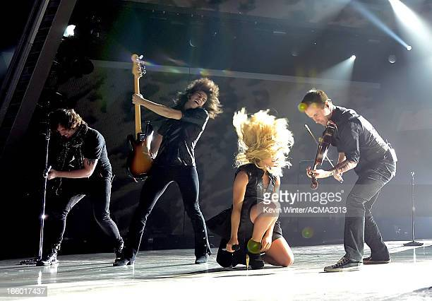 Musicians Neil Perry Reid Perry and Kimberly Perry of The Band Perry perform onstage during the 48th Annual Academy of Country Music Awards at the...