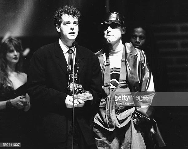 Musicians Neil Tennant and Chris Lowe of band 'Pet Shop Boys' on stage receiving their award for Best British Group at the BRIT Awards London...