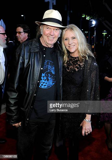 Musicians Neil Young and Pegi Young arrive at the 2012 MusiCares Person of the Year Tribute to Paul McCartney held at the Los Angeles Convention...