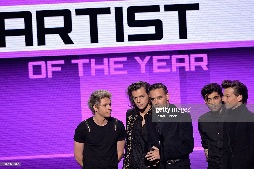 Musicians Niall Horan, Harry Styles, Liam Payne, Zayn Malik and Louis Tomlinson of One Direction speak onstage at the 2014 American Music Awards at Nokia Theatre L.A. Live on November 23, 2014 in Los Angeles, California.