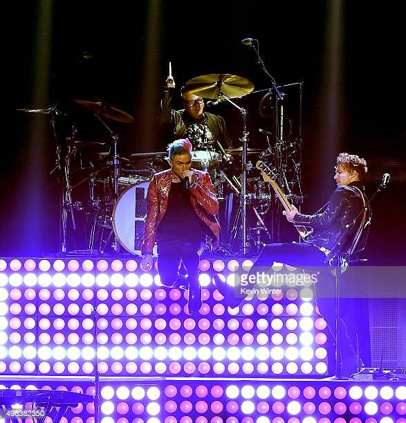 Musicians Nicholas Petricca Sean Waugaman and Kevin Ray of Walk The Moon perform onstage during the 2015 American Music Awards at Microsoft Theater...