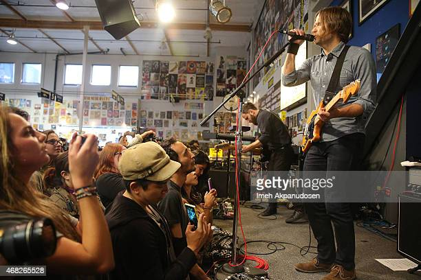 Musicians Nick Harmer and Ben Gibbard of Death Cab for Cutie perform onstage for the release of their new album 'Kintsugi' at Amoeba Music on March...