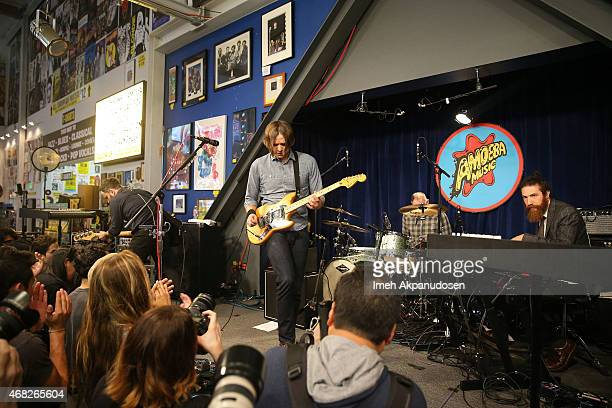 Musicians Nick Harmer Ben Gibbard Jason McGerr and Zac Rae of Death Cab for Cutie perform onstage for the release of their new album 'Kintsugi' at...